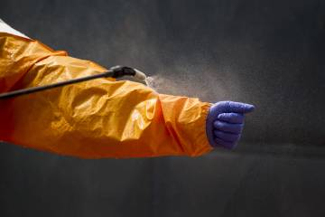 An ebola suit is disinfected