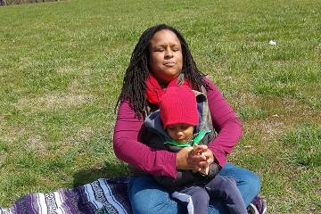 Essence Pierce and her son Joshua relax on the grounds of Lake Montebello near their home in Ednor Gardens.