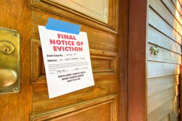 Eviction notice on a wooden door