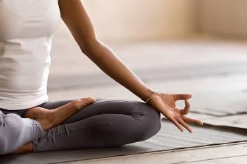 Woman practicing yoga, doing Ardha Padmasana exercise