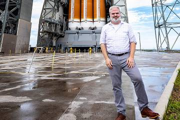 Geoff Brown in front of the rocket that would launch the Parker Solar Probe