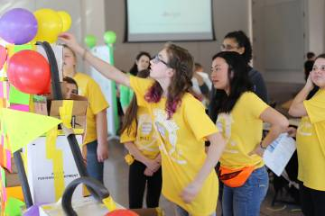 Girl scouts test a roller coaster