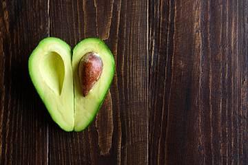 Avocado cut in half in shape of a heart