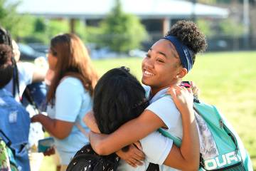 Two students hug on the first day of school