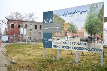 Promo billboard depicts the future design of Henderson Crossing