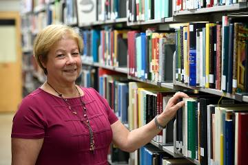 Liz Mengel, associate director of Collections & Academic Services, in the stacks at the Milton S. Eisenhower Library at Homewood.