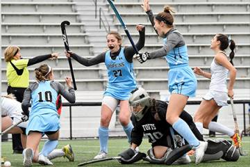 Johns Hopkins field hockey team celebrates a goal