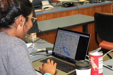 A student looks at points plotted on a Baltimore City map