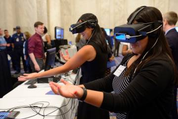 Women wear virtual reality headsets