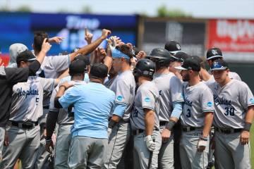 Johns Hopkins baseball team huddles after a game