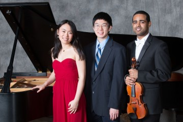 Student soloists Stephanie Cai, Winston Wu, Jordan Elum stand in front of piano
