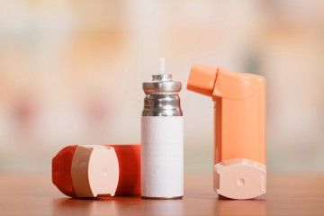 Two inhalers and a canister of albuterol