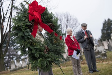 A wreath placed at the tombstone marks the completion of the brief ceremony held each year.