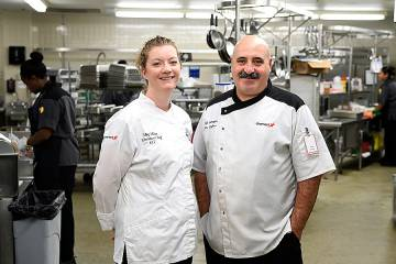 Meg Miller and Petar Stoykov in the Keswick Cafe kitchenMeg Miller and Petar Stoykov are among those who arrive at work each day before sunrise so that breakfast is ready for arriving employees.
