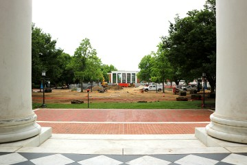 Image of sod and exposed dirt on Keyser Quad, with MSE Library in the background