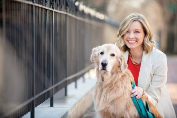 Pollster Kristen Soltis Anderson poses with her golden retriever, Wally
