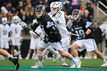 Hopkins lacrosse player evades Loyola defender