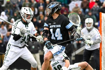 Hopkins lacrosse player heads toward the goal