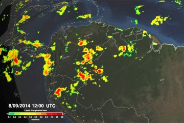 Pockets of intense precipitation in red and yellow are seen over a map of northern South America