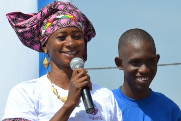 A woman with a microphone and a man