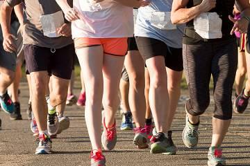 Closeup of runners' legs