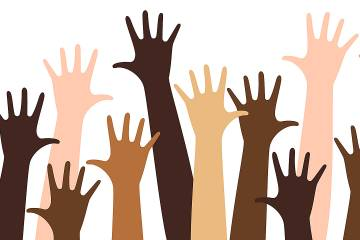 Illustration of raised hands in many different skin tones