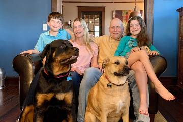 The Montcalmo family—Luca, Rebekah, Joseph, and Juliet—at home with their dogs Dutch and Sami