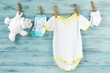Clothesline holding baby clothes and toy