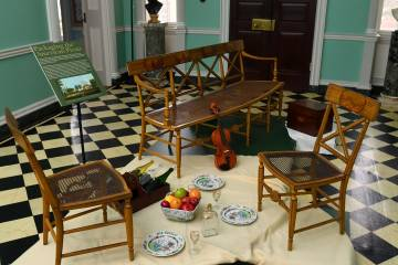 Table and chair setup from museum exhibit