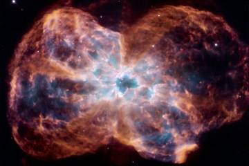 Image of a colorful nebula with a white-hot center