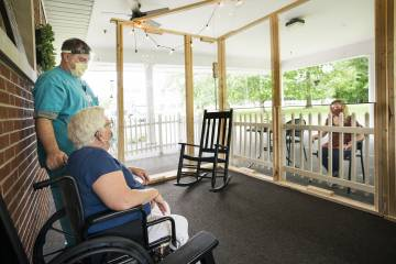 Nursing home resident meets with a family member outdoors