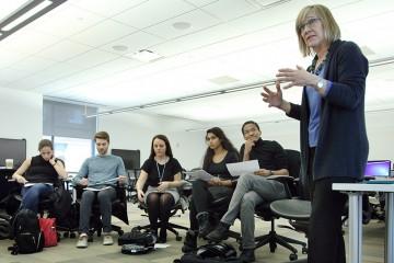 A woman teaches a class