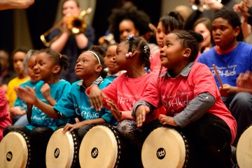 OrchKids play drums at Shriver Hall concert