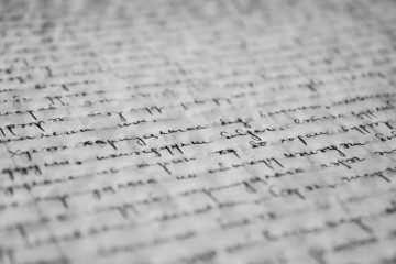 A close-up of cursive writing on lined paper