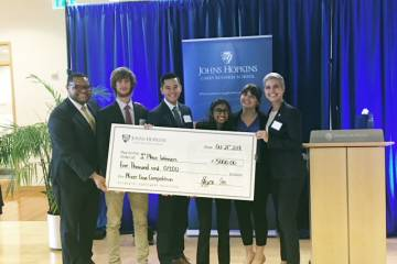 A group photo of case competition winners