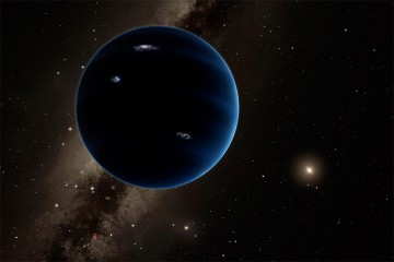 Large, dark planet illuminated by distant sun