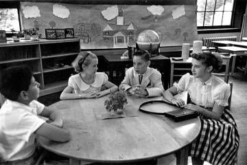 Black and white photo of children on a television set