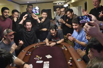 Avi Rubin loses his poker hand as students look on in amazement