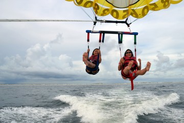 two girls parasailing