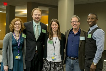 Five people pose at the Johns Hopkins Postdoctoral Retreat