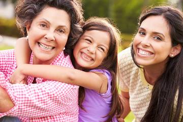Three generations of women—a grandmother of pre-retirement age with her daughter and young granddaughter