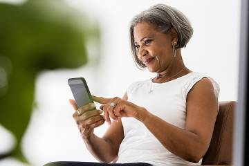 Woman using an app on her mobile phone