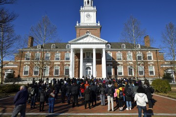Students gather in front of Gilman Hall