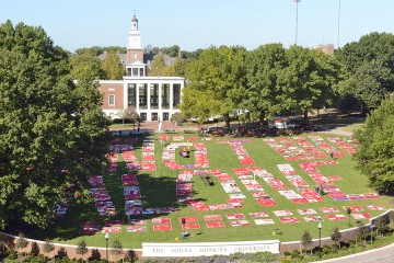 Aerial shot of the Monument Quilt on the JHU Beach, forming the words