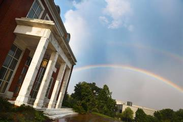 A rainbow appears over Mason Hall