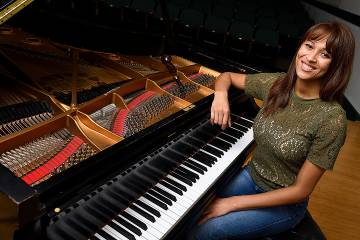 Renee Kelsey at one of the 256 Peabody-owned pianos that she and two other technicians keep finely tuned.