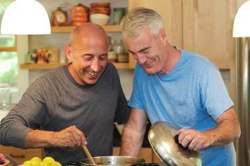 Two senior men enjoying cooking together