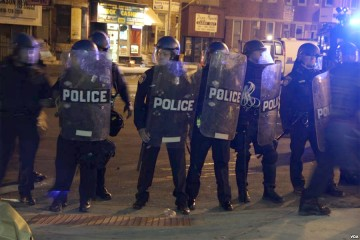 Line of police in riot gear