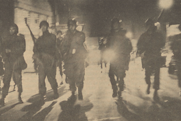 Yellowed newspaper clipping of riot police