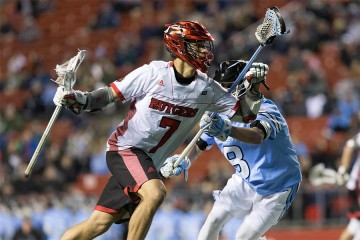 A Rutgers lacrosse player goes to goal vs. Hopkins